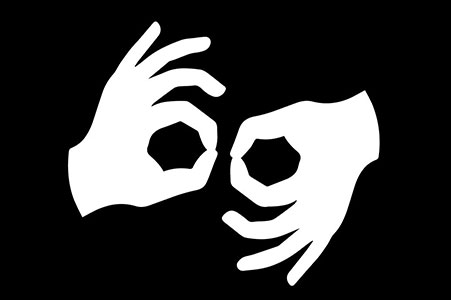 silhouette of white hands on black background making auslan signs