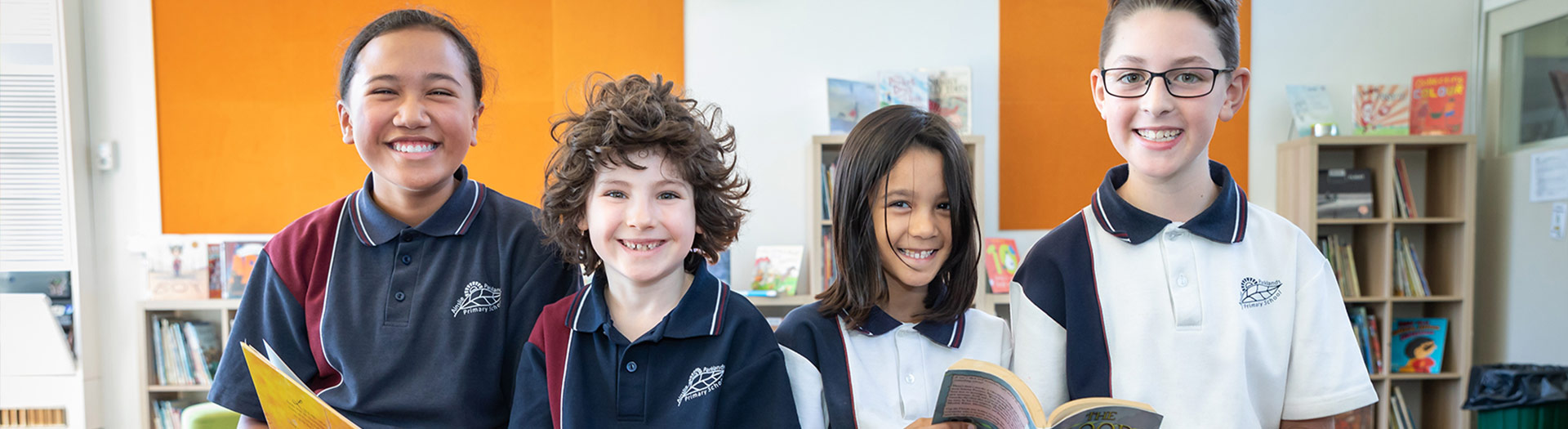 smiling students in a school library